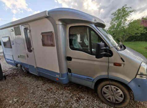 camping-car BURSTNER DELFIN T 680  extérieur / latéral droit
