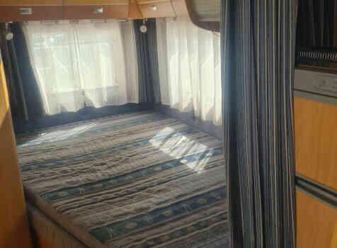 camping-car CHALLENGER EDEN 601  intérieur / couchage principal