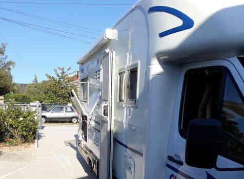 camping-car CI CYPRO 55  extérieur / latéral droit