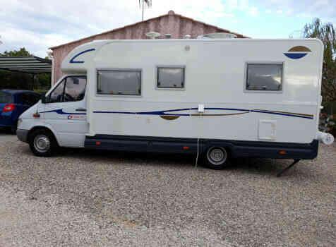 camping-car CI CYPRO 55  extérieur / latéral gauche